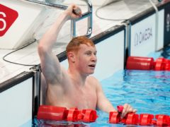 Great Britain's Tom Dean celebrates winning the Men's 200m Freestyle at Tokyo Aquatics Centre on the fourth day of the Tokyo 2020 Olympic Games in Japan. Picture date: Tuesday July 27, 2021.