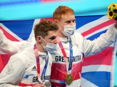 Great Britain's Tom Dean (right) with his gold medal celebrates after winning the Men's 200m Freestyle alongside second placed silver medalist Great Britain's Duncan Scott (Joe Giddens/PA)