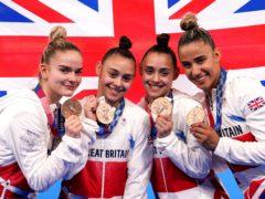 Great Britain's Alice Kinsella, Jennifer Gadirova, Jessica Gadirova and Amelie Morgan celebrate with their bronze medals (Martin Rickett/PA)