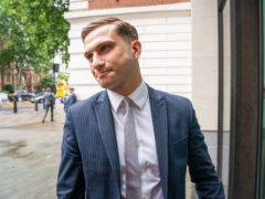 Lewis Hughes, 24, arrives at Westminster Magistrates' Court in London, where he is charged with common assault, after the Chief Medical Officer for England Chris Whitty, was accosted in St James's Park, central London, on Sunday June 27. Picture date: Friday July 30, 2021.