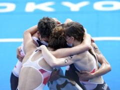 The British team celebrate their mixed relay gold (Danny Lawson/PA)