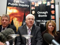Michael Gallagher, centre, and other relatives of victims of the Omagh terrorist attack have continued to fight for justice (PA)