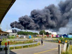 A dark cloud of smoke rises into the air in Leverkusen, Germany (Mirko Wolf/dpa via AP)