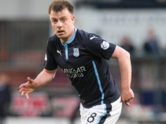 Paul McGowan headed a late equaliser for Dundee against Hibernian (Jeff Holmes/PA Images).