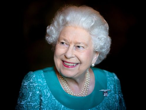 The nation will celebrate the Queen's Platinum Jubilee with a four-day bank holiday weekend next June (Jane Barlow/PA)