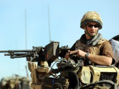 Prince Harry sitting in his position on a Spartan armoured vehicle in Helmand province (PA)