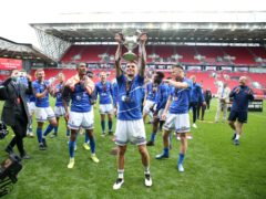 Hartlepool United's Gavan Holohan celebrates with the trophy after winning the shoot-out and promotion after the Vanarama National League play-off final at Ashton Gate, Bristol.