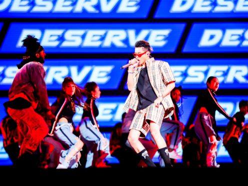 Singer Kris Wu, centre, performing in 2017 (Chinatopix/AP)