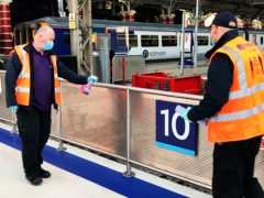 Handrails being cleaned at Liverpool Lime Street station (Network Rail/PA)
