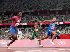 Italy's Lamont Jacobs (right) wins the men's 100 metres at the Tokyo Olympics (Martin Rickett/PA Images).
