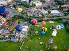 Balloons take off from Filton for Bristol International Balloon Fiesta (Ben Birchall/PA)