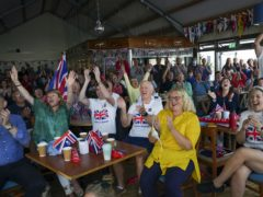 Family and friends of Olympic gold medallist Eilidh McIntyre celebrate at Hayling Island Sailing Club, Hampshire, as her boat crosses the finish line at Tokyo 2020 (Steve Parsons/PA)