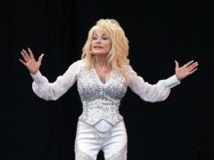 Dolly Parton feels she got too much credit for helping fund Covid vaccine (Yui Mok/PA)