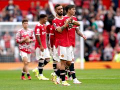 Manchester United's Bruno Fernandes holds the match ball (Martin Rickett/PA)