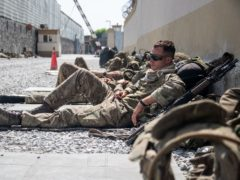 A member of the UK Armed Forces, who continue to take part in the evacuation of entitled personnel, taking a rest at Kabul airport (LPhot Ben Shread/MoD/PA)