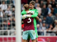 Wayne Hennessey and Charlie Taylor celebrate Burnley's victory (Owen Humphreys/PA)