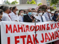 Malaysian opposition members take part in the protest (AP)