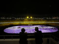 World Health Organisation director-general Tedros Adhanom Ghebreyesus, left, and United Nations High Commissioner for Refugees Filippo Grandi watch the opening ceremony at the 2020 Summer Olympics in Tokyo (Leon Neal/AP)