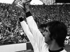 Gerd Muller holds the World Cup aloft after West Germany's victory in 1974 (AP).