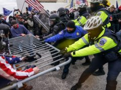 The riots at the Capitol in Washington. (John Minchillo/AP)