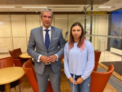 Belarusian Olympic sprinter Krystsina Tsimanouskaya, right, who seeks foreign refuge from Minsk authorities, poses with top Belarusian dissident in Poland, Pavel Latushko, left (National Anti-crisis Management via AP)