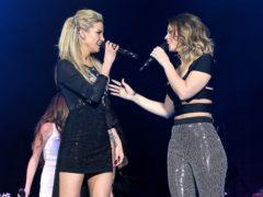 Sarah Harding performing with Girls Aloud bandmate Kimberley Walsh (Yui Mok/PA)