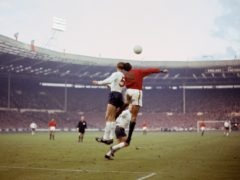 Jack Charlton, who was to develop dementia in later life, heads a ball for England (PA)
