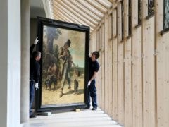 Art technicians remove a Burrell Collection painting ahead of the museum's renovation (Jane Barlow/PA)