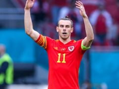 Gareth Bale was seen holding his ankle after being kicked at the end of Wales' 0-0 draw with Finland in Helsinki (PA)