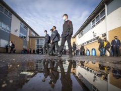 Students arriving at St Andrew's RC Secondary School in Glasgow (Jane Barlow/PA)