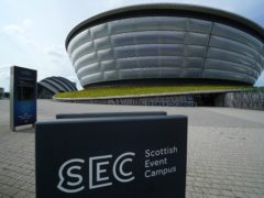 Glasgow will host Cop26 but it remains unclear whether delegates and protesters will need to prove they are fully vaccinated (Andrew Milligan/PA)
