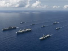 The UK Carrier Strike Group's warships led by aircraft carrier HMS Queen Elizabeth as they work with the USS America-led United States Expeditionary Strike Group 7 and two ships from Japan's Maritime Self Defence Force (LPhot Dan Rosenbaum/PA)