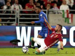 Raheem Sterling, left, was targeted for racist abuse during England's match in Hungary (Attila Trenka/PA)