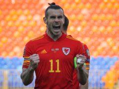 Hat-trick hero Gareth Bale celebrates Wales' 3-2 World Cup qualifying win over Belarus in Kazan (Alexei Nasyrov/AP)