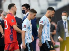 Argentina players leave the field in Sao Paulo after an on-pitch intervention by Brazilian health authority officials (Andre Penner/AP)