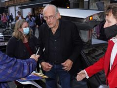 Christopher Lloyd steps out of a DeLorean (Ian West/PA)