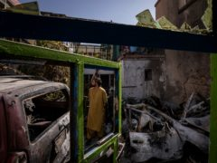 An Afghan inspects the damage of Ahmadi family house in Kabul (AP)