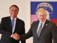 Prime Minister Boris Johnson (right) shakes hands with Brazil's president Jair Bolsonaro (Michael M Santiago/PA)