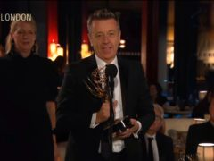 The Crown creator Peter Morgan received an Emmy Award for the regal drama in what was an historic moment for Netflix (Television Academy via AP)