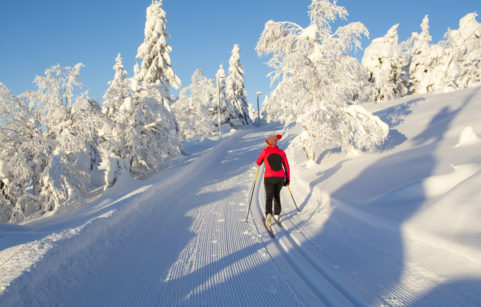 Woman cross country skiing in Finland