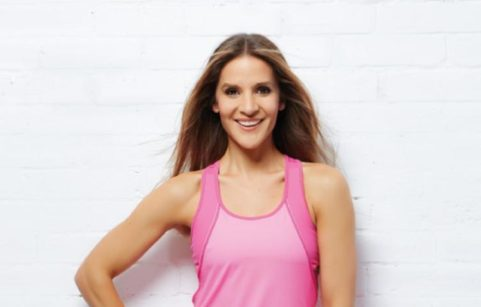 Amanda Byram posing in fitness gear
