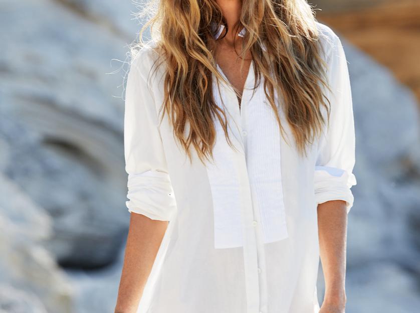 Elle Macphearson standing on a beach