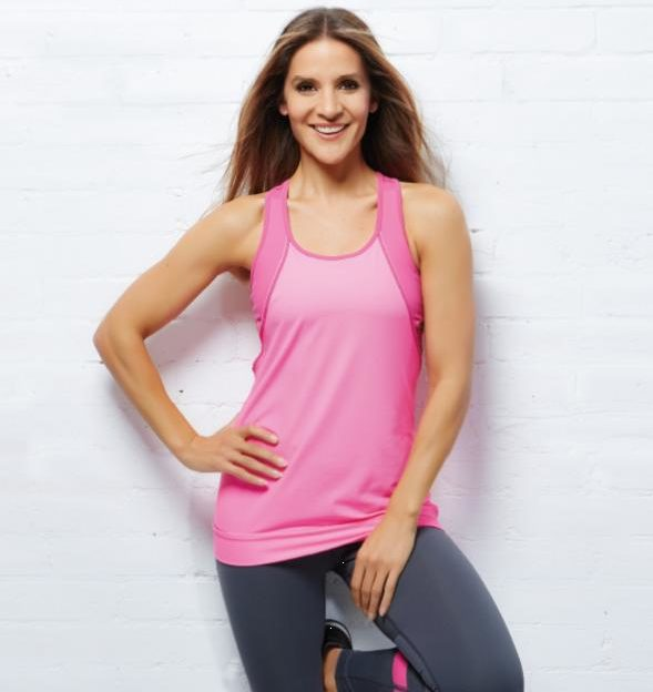Amanda Byram posing in sports gear