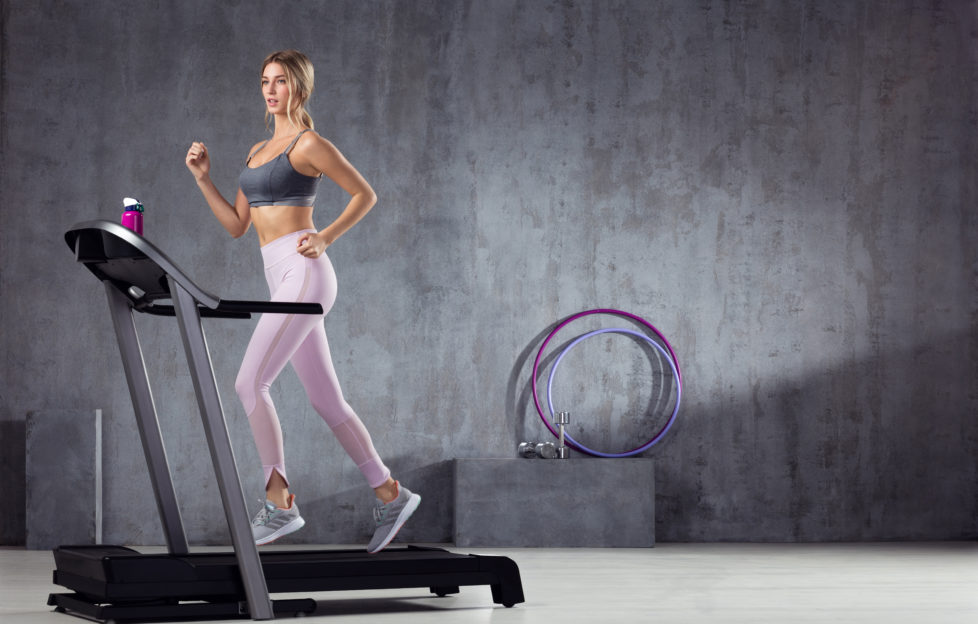 A woman working-out on treadmill