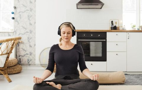 woman meditating at home stress relief