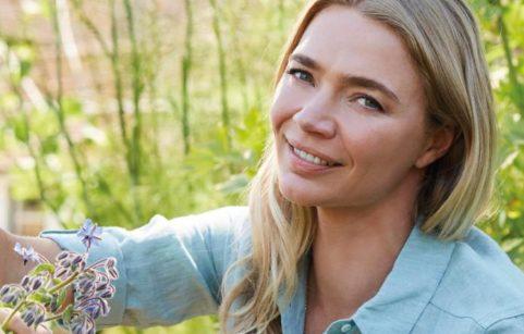Jodie Kidd picking wild flowers