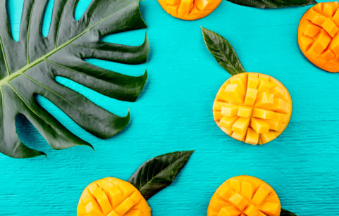 Prepared mango on a bright blue background