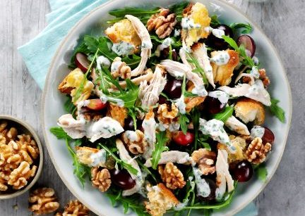 A chicken and walnut salad in a bowl
