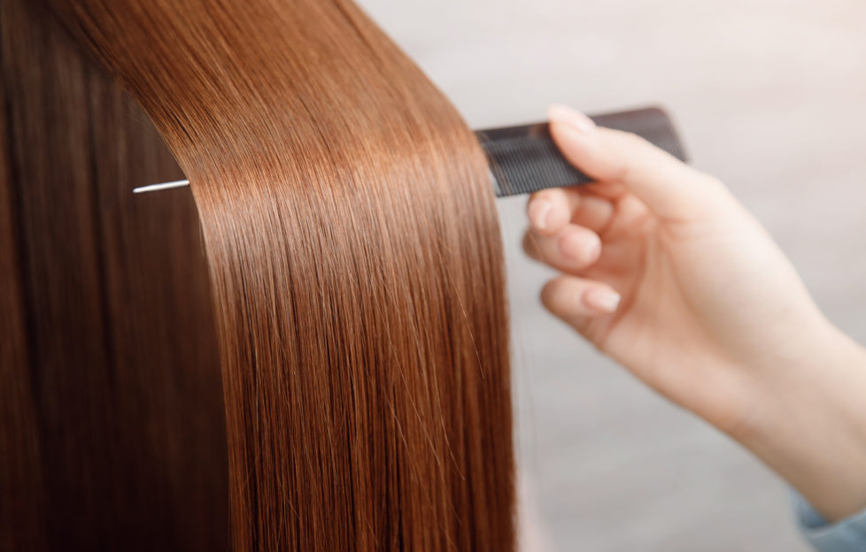 Shiny hair being brushed