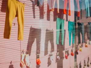 hanging clothes on pink background